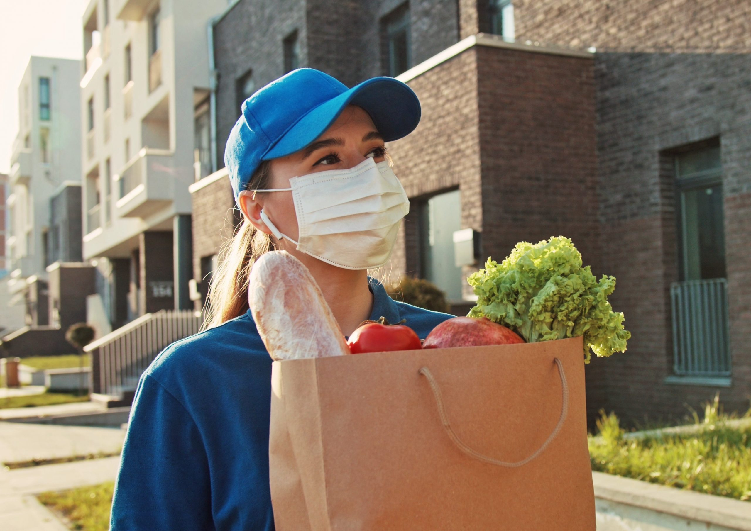close-up-portrait-young-courier-woman-holding-food-craft-bag-modern-safety-food-delivery-service-a_t20_e9P792